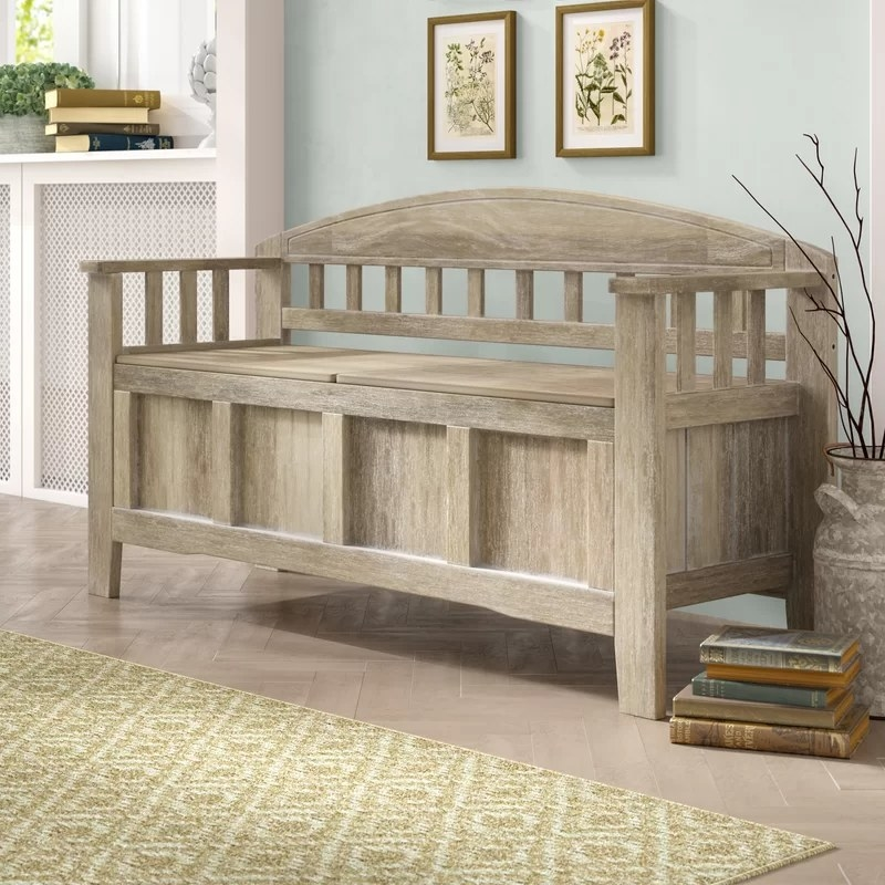 The light wood bench in an entryway