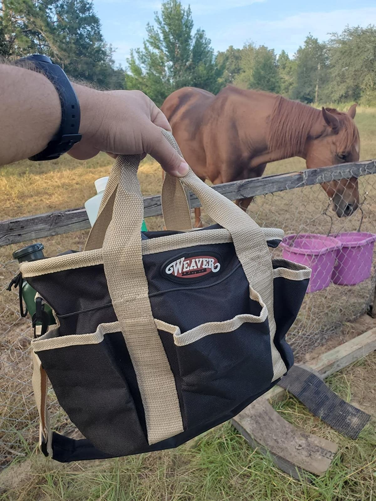 Reviewer image of heavy duty tote filled with horse grooming materials