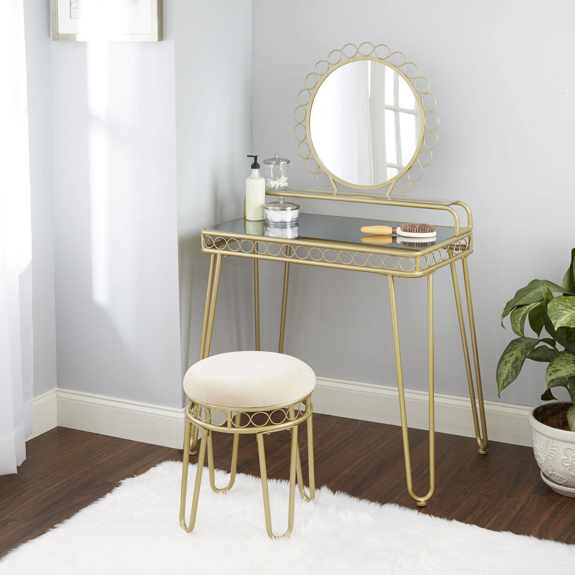 The gold and mirrored vanity table and stool