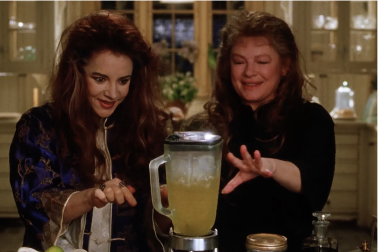 Channing and Weist smile while blending up margaritas
