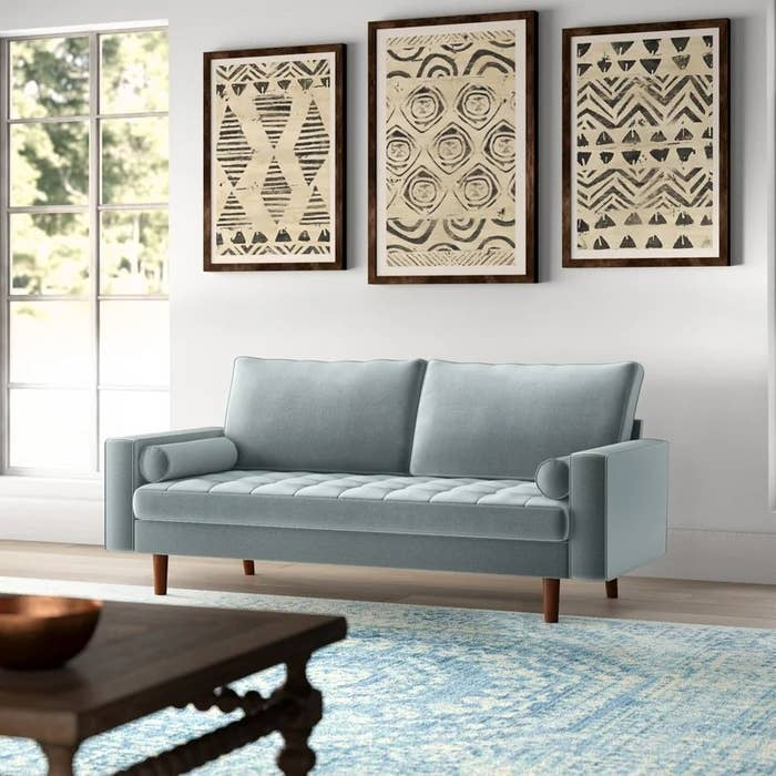 The sofa, in gray, in a living room