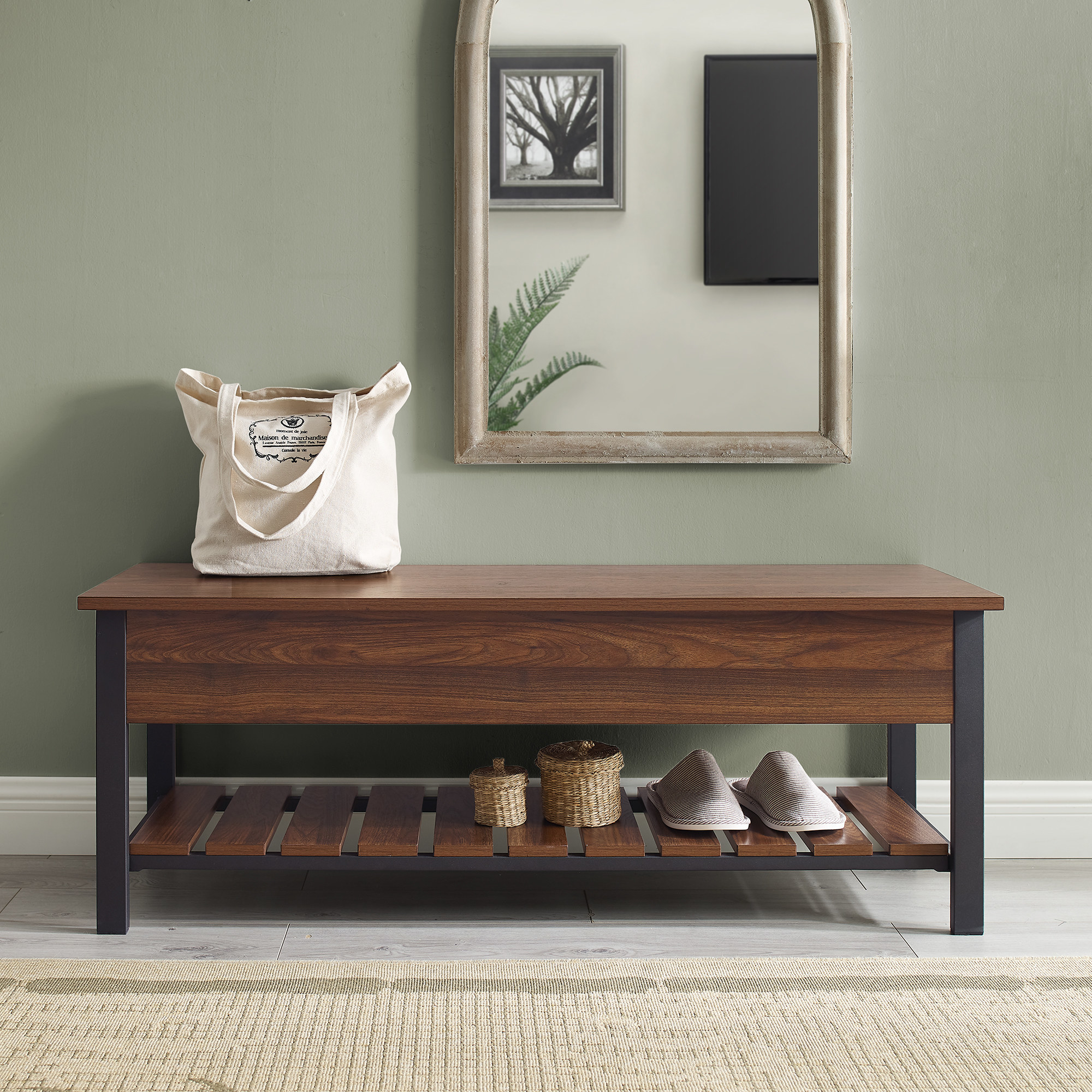 The dark wood bench in an entryway