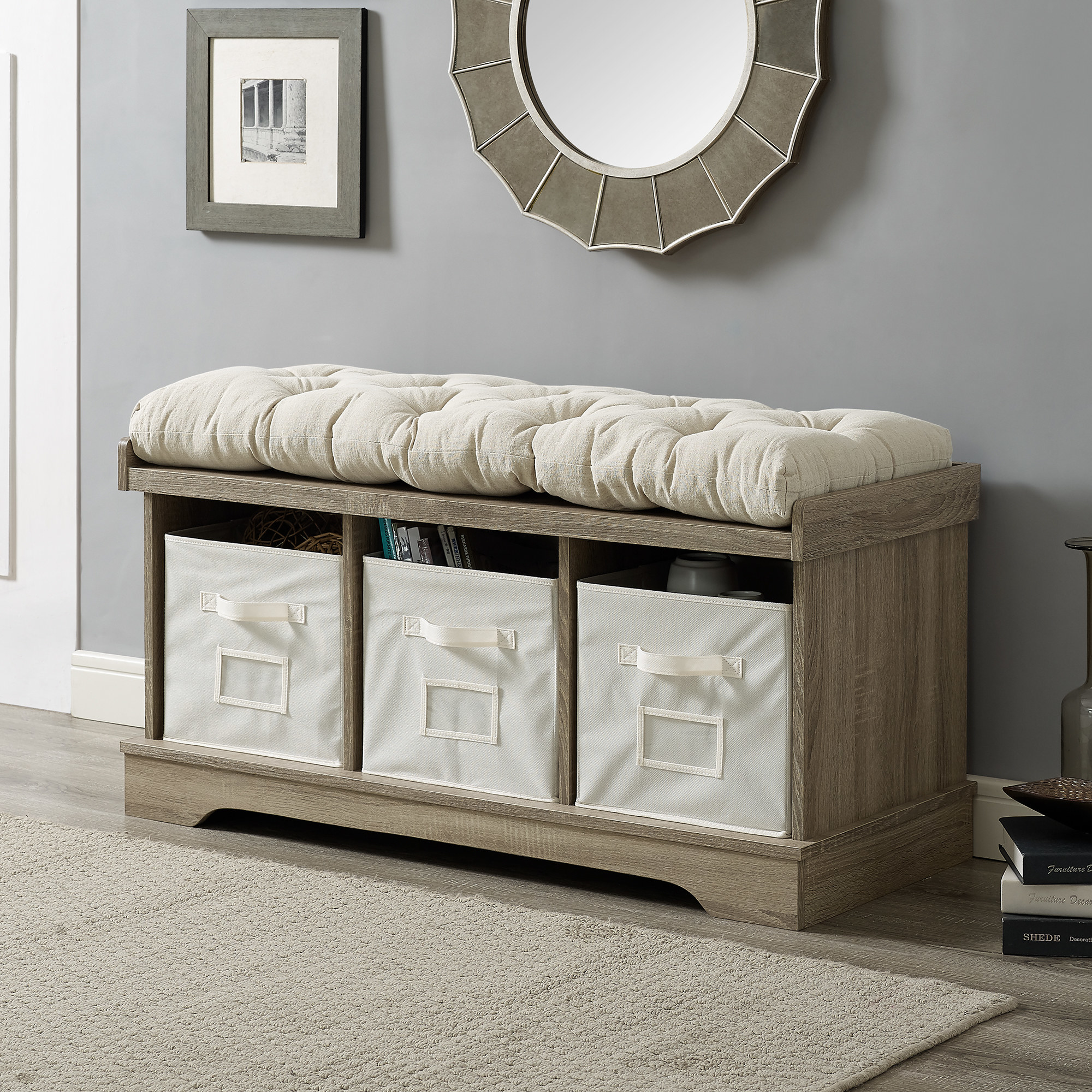The wooden bench with a cream cushion and storage cubes