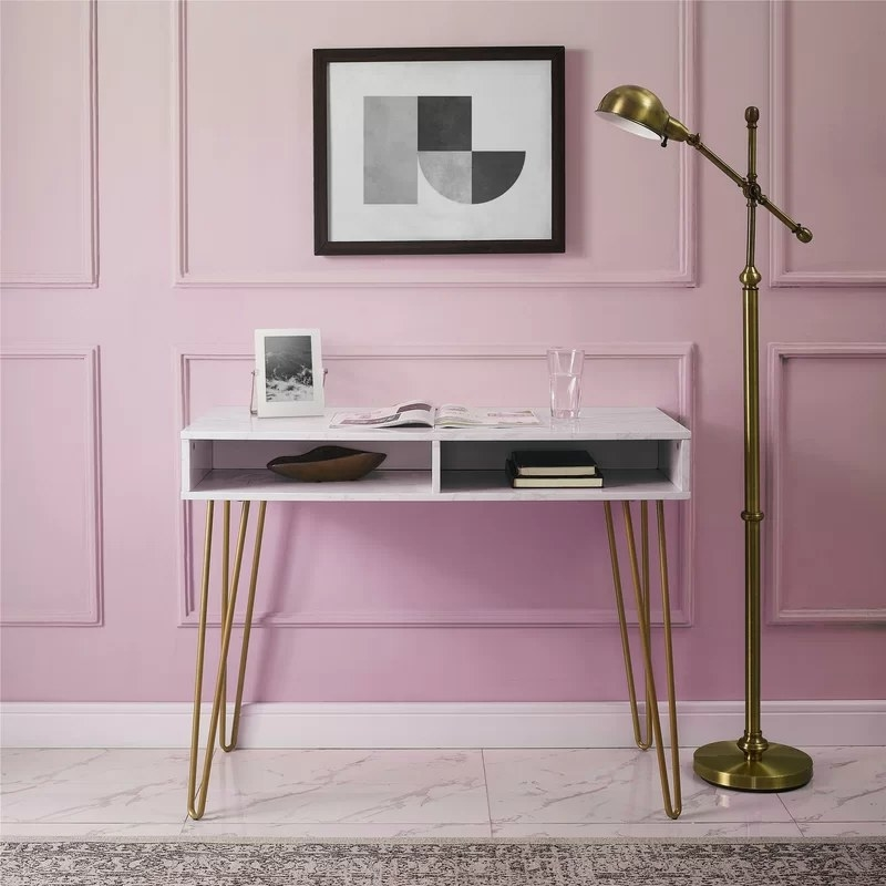 The desk in white with gold legs