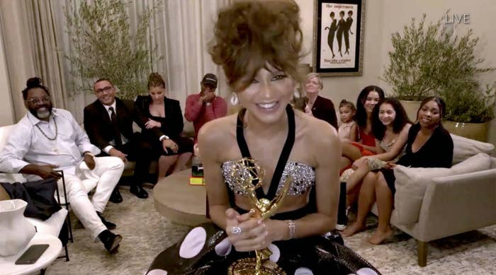 Zendaya holding her Emmy and her family in the background