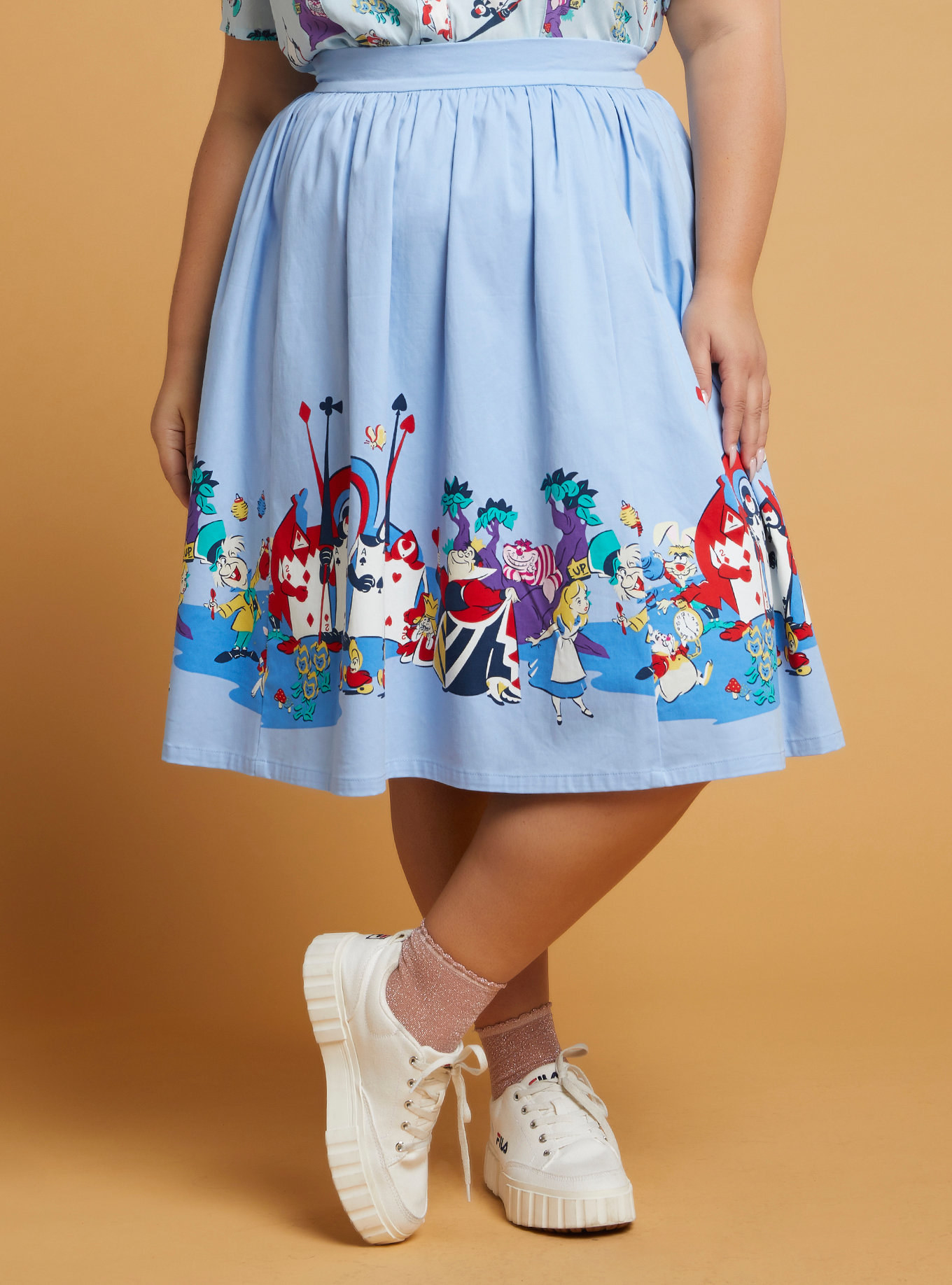 High waisted skirt with Alice in Wonderland characters on hemline
