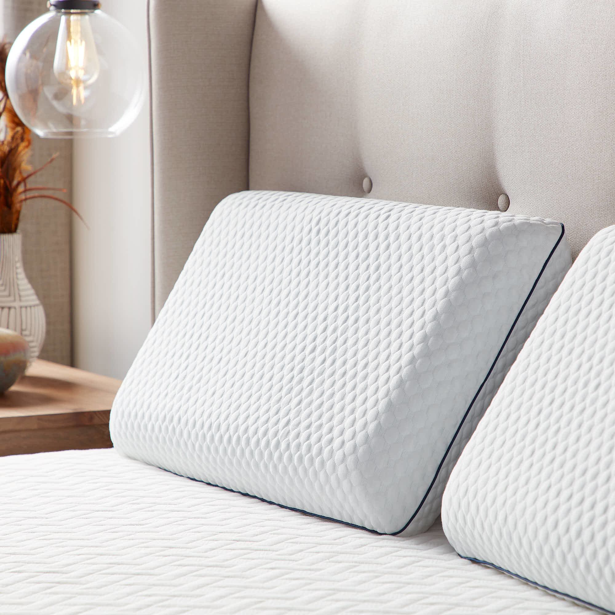 a gel foam memory pillow displayed on a bed