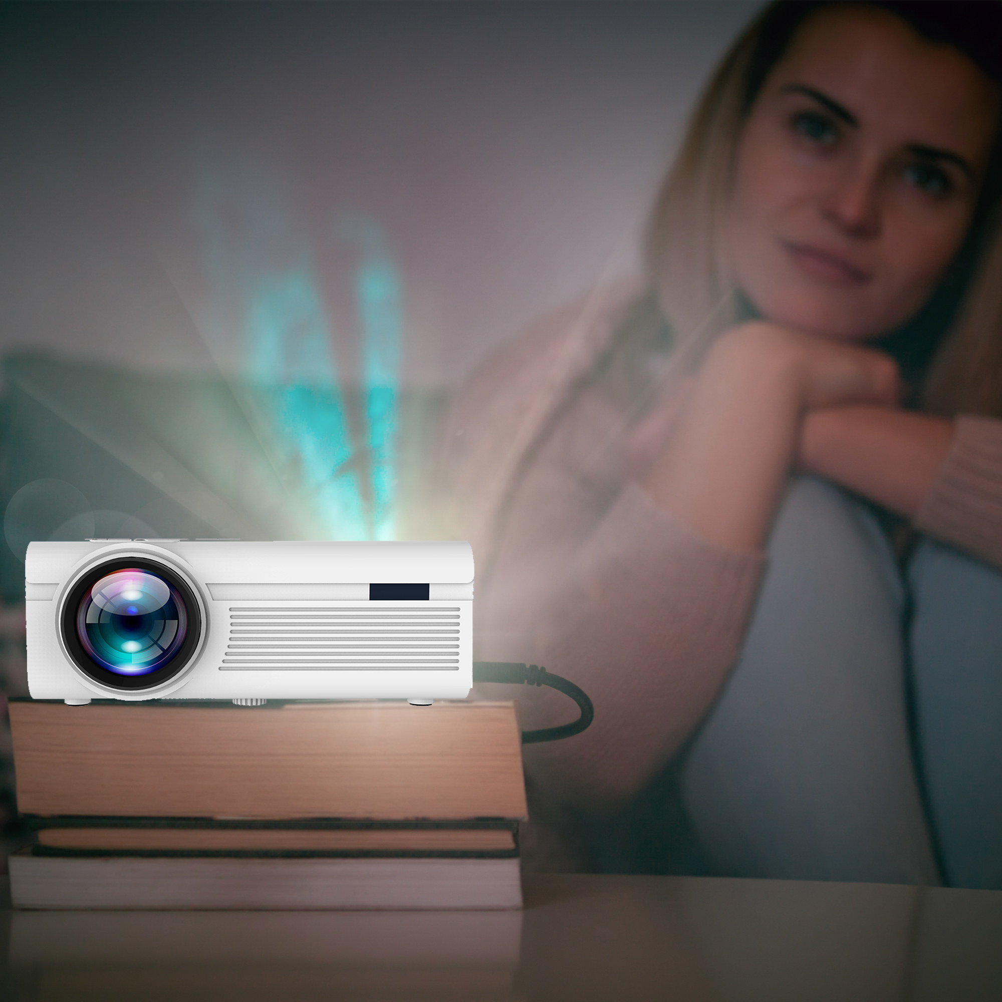 a girl watching a movie that is playing from the projector