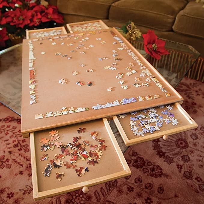 The puzzle plateau with its drawers pulled out and holding pieces