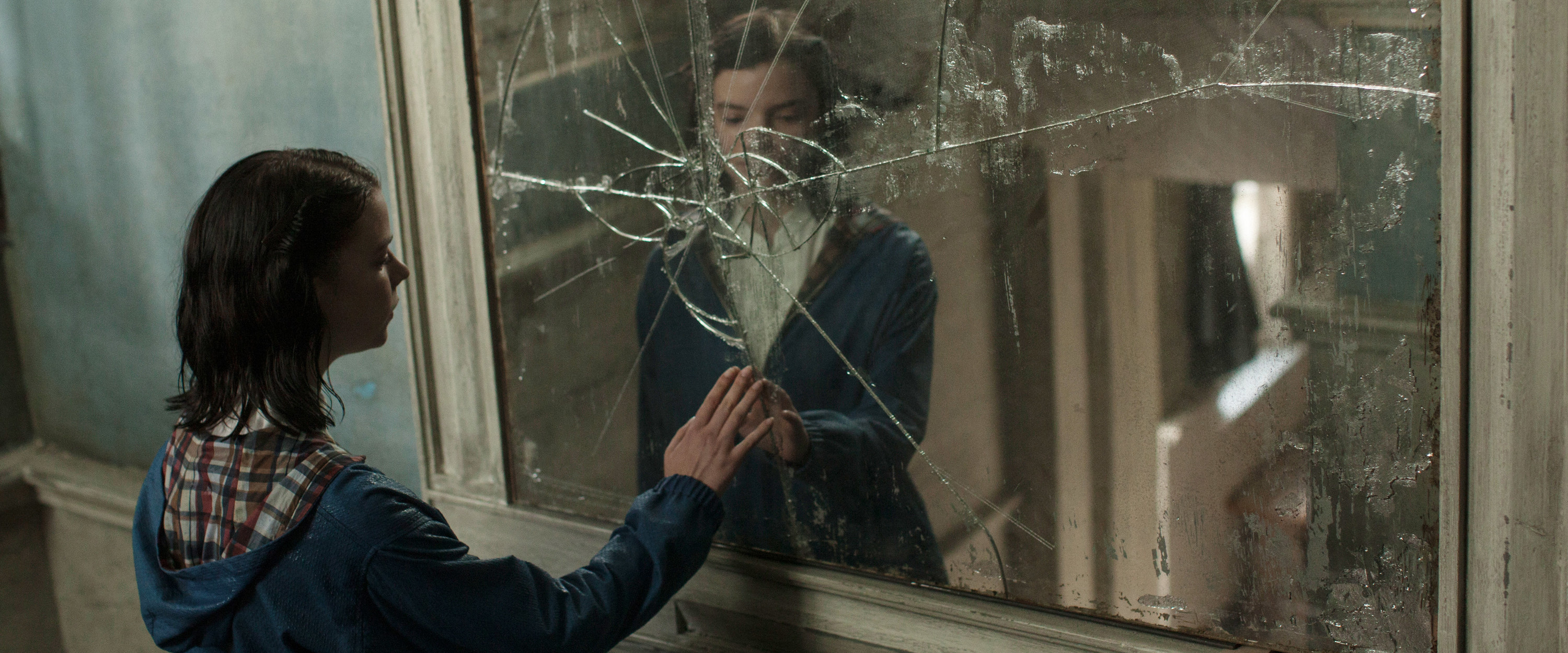 Anya as Allie touching a cracked mirror