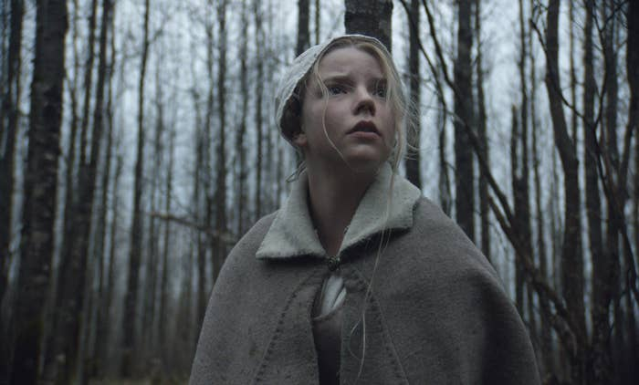 Anya Taylor-Joy as Thomasin standing in the woods