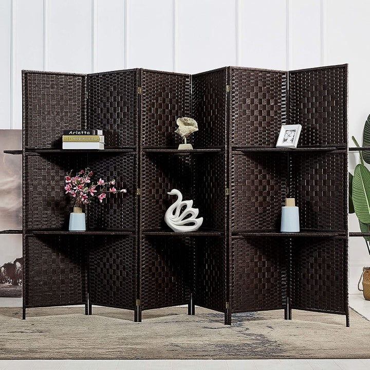 the room divider with shelves in dark brown