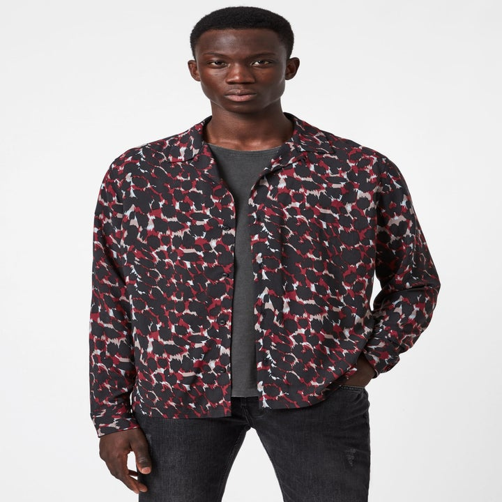 model wearing a red and black animal print shirt