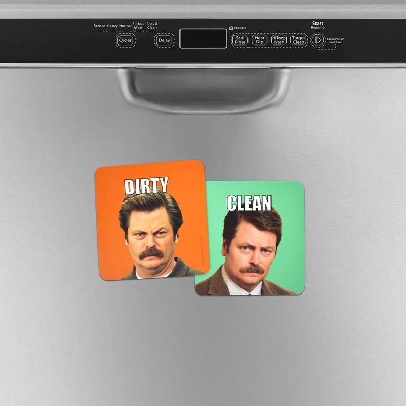 "a set of two Ron Swanson dishwasher magnets with Ron grimacing on the ""dirty"" magnet"
