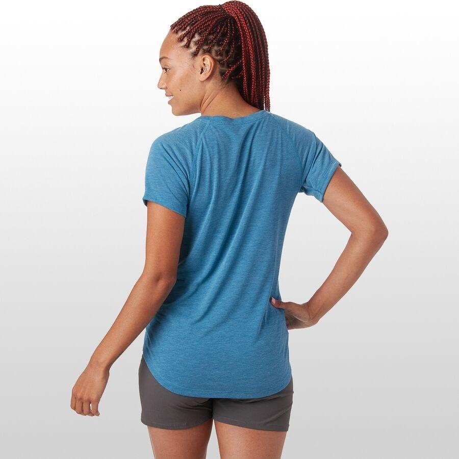 Model wears blue, lightweight T-shirt with loose black running shorts