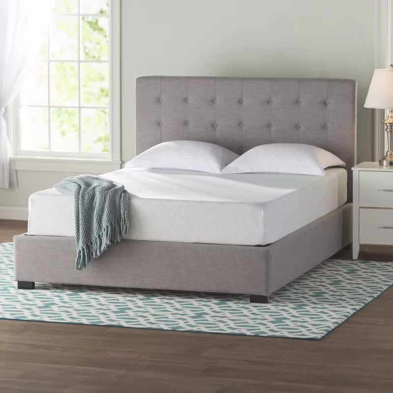 The mattress on top of a queen-sized bed