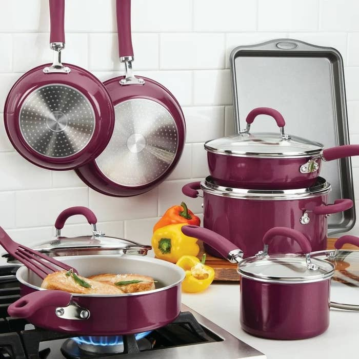 The burgundy cookware set being used in a kitchen