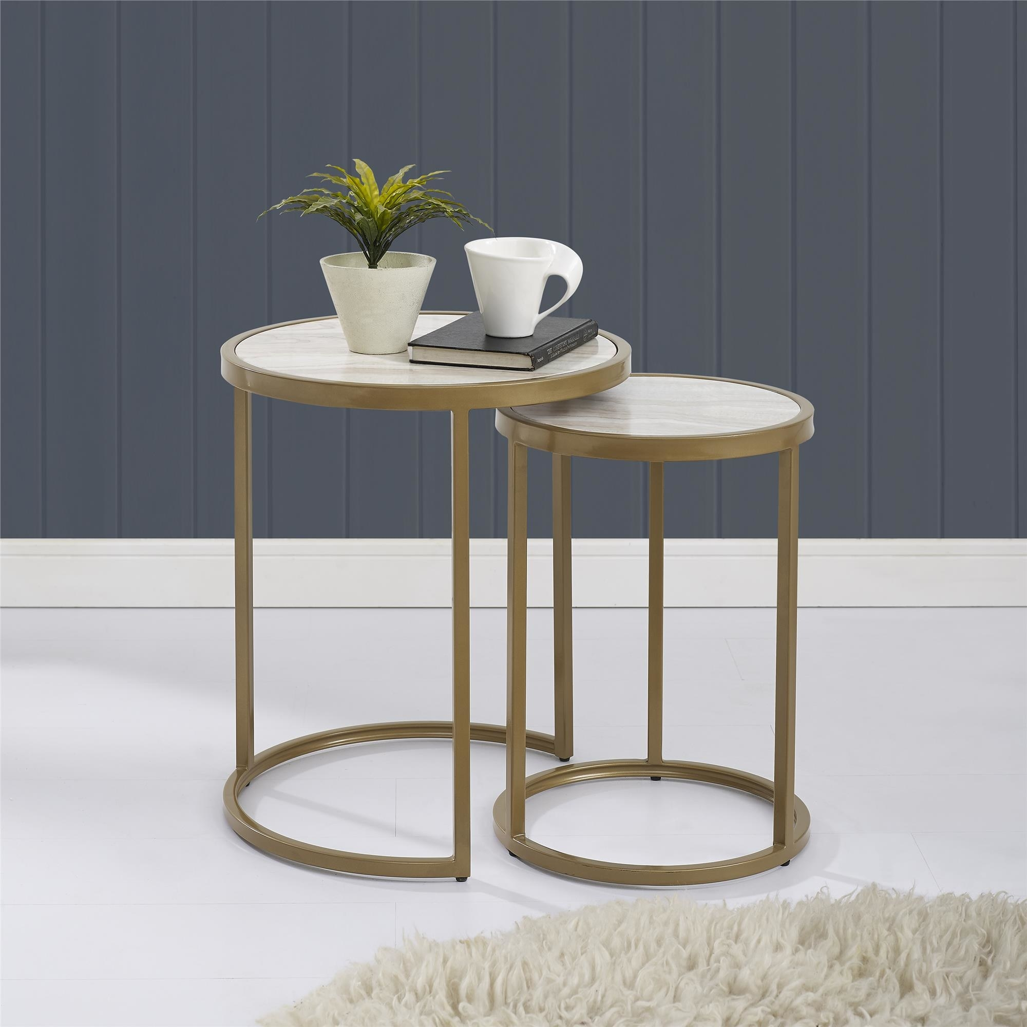 the side table displayed with a book, plant, and cup of coffee on top of it