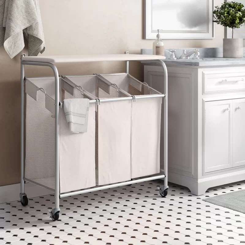 The laundry basket on wheels in a bathroom