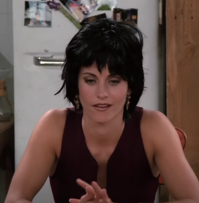 Monica with a really short choppy bob with bangs