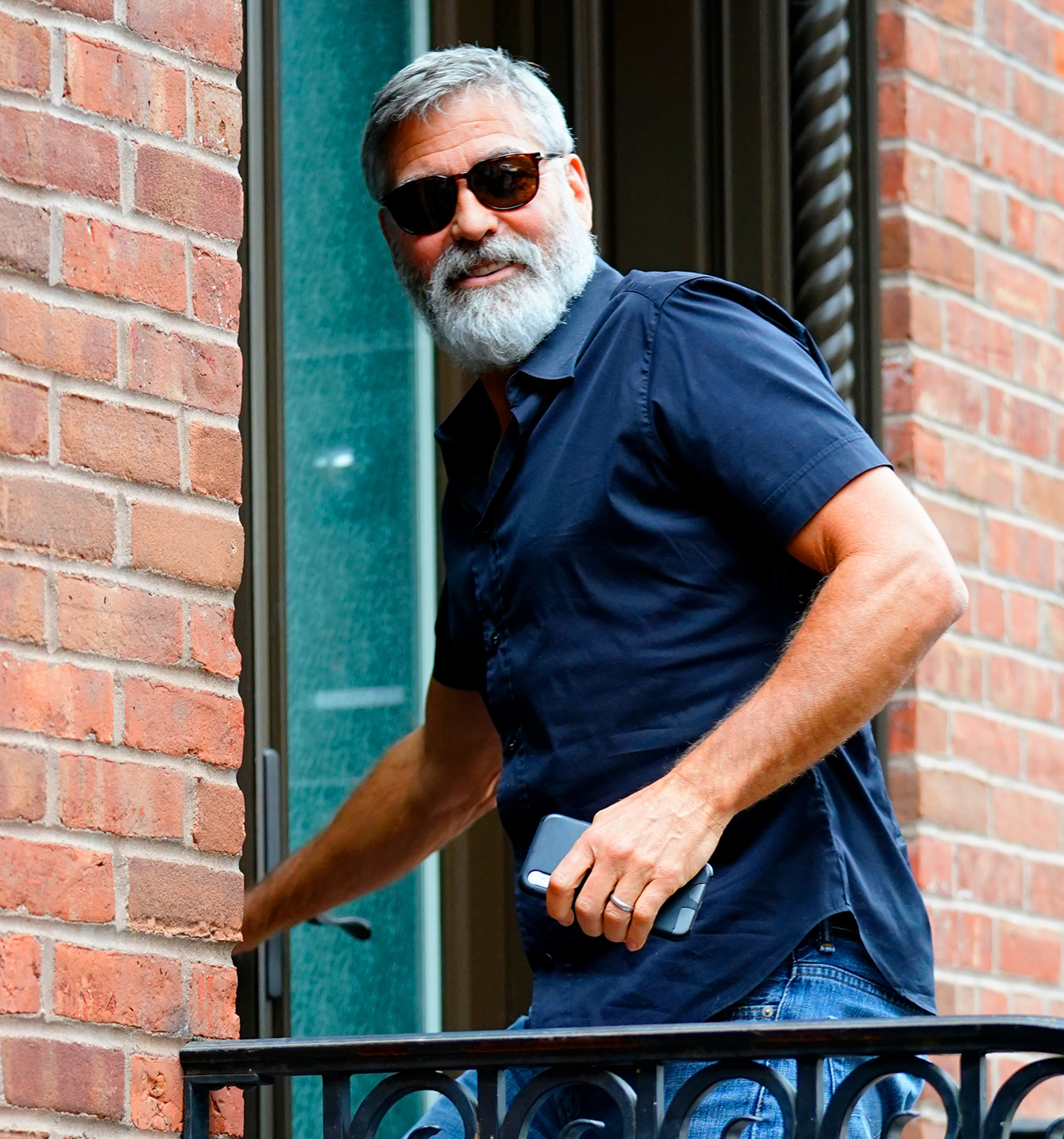 George Clooney entering a building