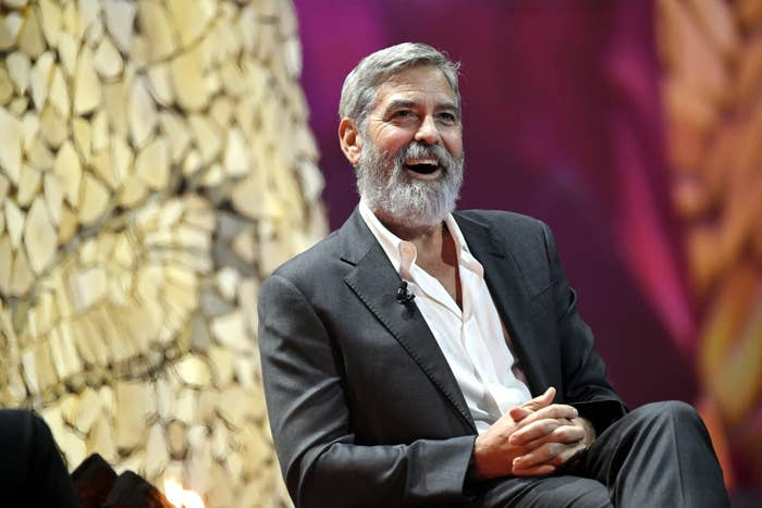 US actor and director George Clooney laughs during the Nordic Business Forum business seminar in Helsinki, Finland