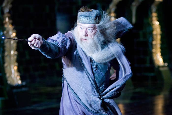 Dumbledore brandishing his wand and casting a powerful spell