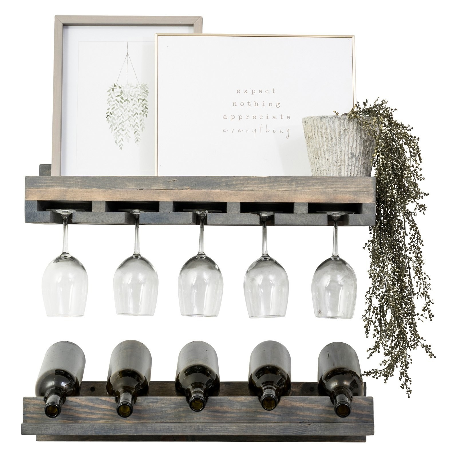 the wine rack displayed with wine glasses, plants, and decorations on it