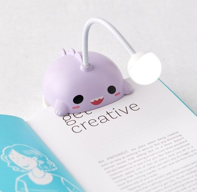 the purple angelfish light clipped to a book