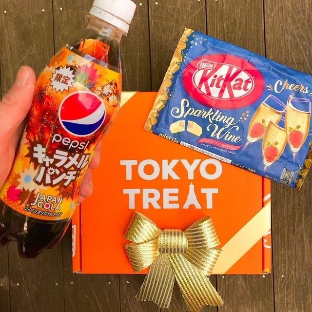 a bottle of pepsi from japan and sparkling wine kit kats