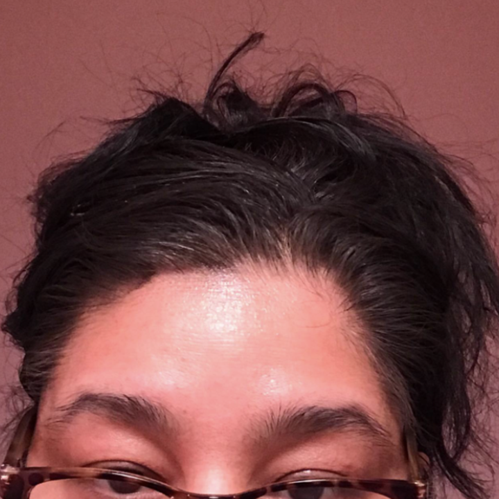 Reviewer after photo of black hair after using Root Cover Up