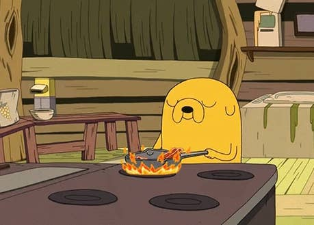 "Jake the Dog from ""Adventure Time"" making bacon and eggs"
