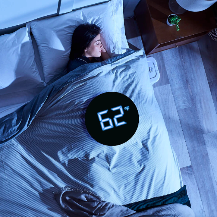 Person sleeping in bed with ChiliSleep system beside bed and graphic showing the bed at 62 degrees