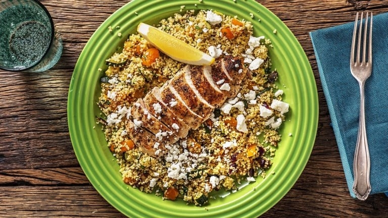 Lemon chicken with roasted vegetables and couscous and feta