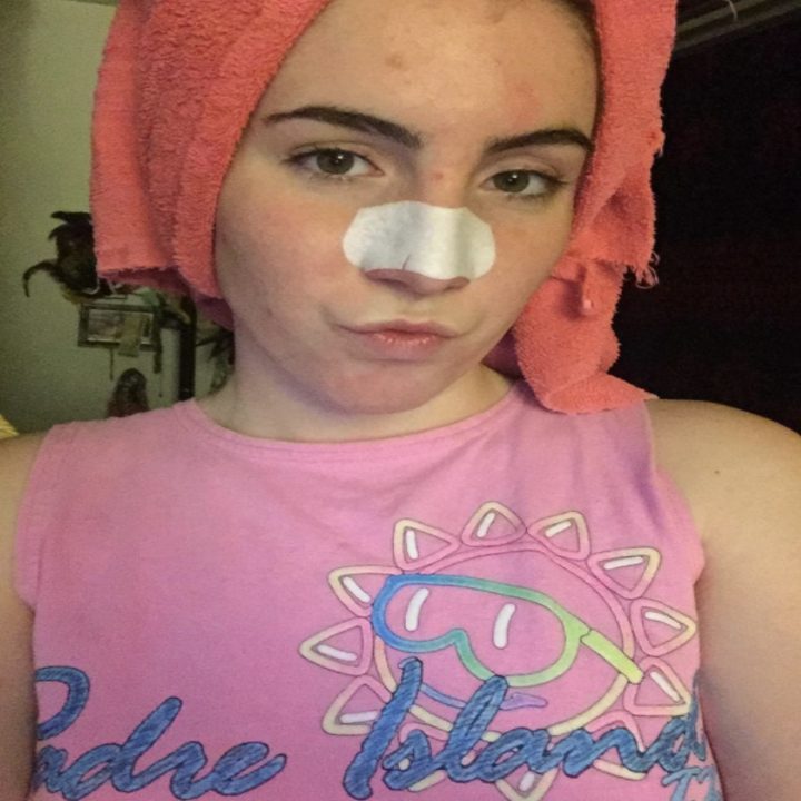 Reviewer photo of woman wearing pore strips on nose