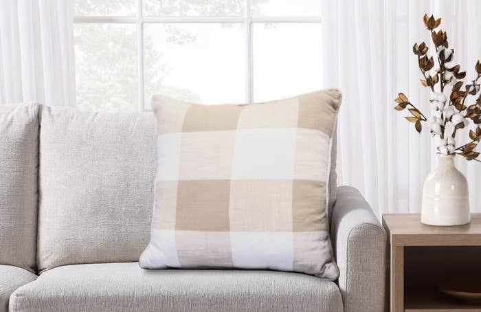 The plaid decorative pillow in white