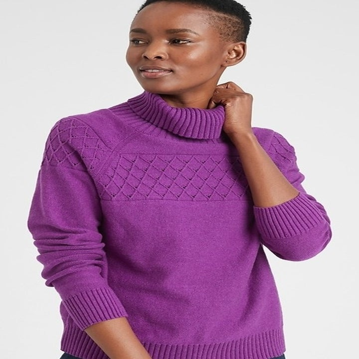 model wearing purple turtleneck