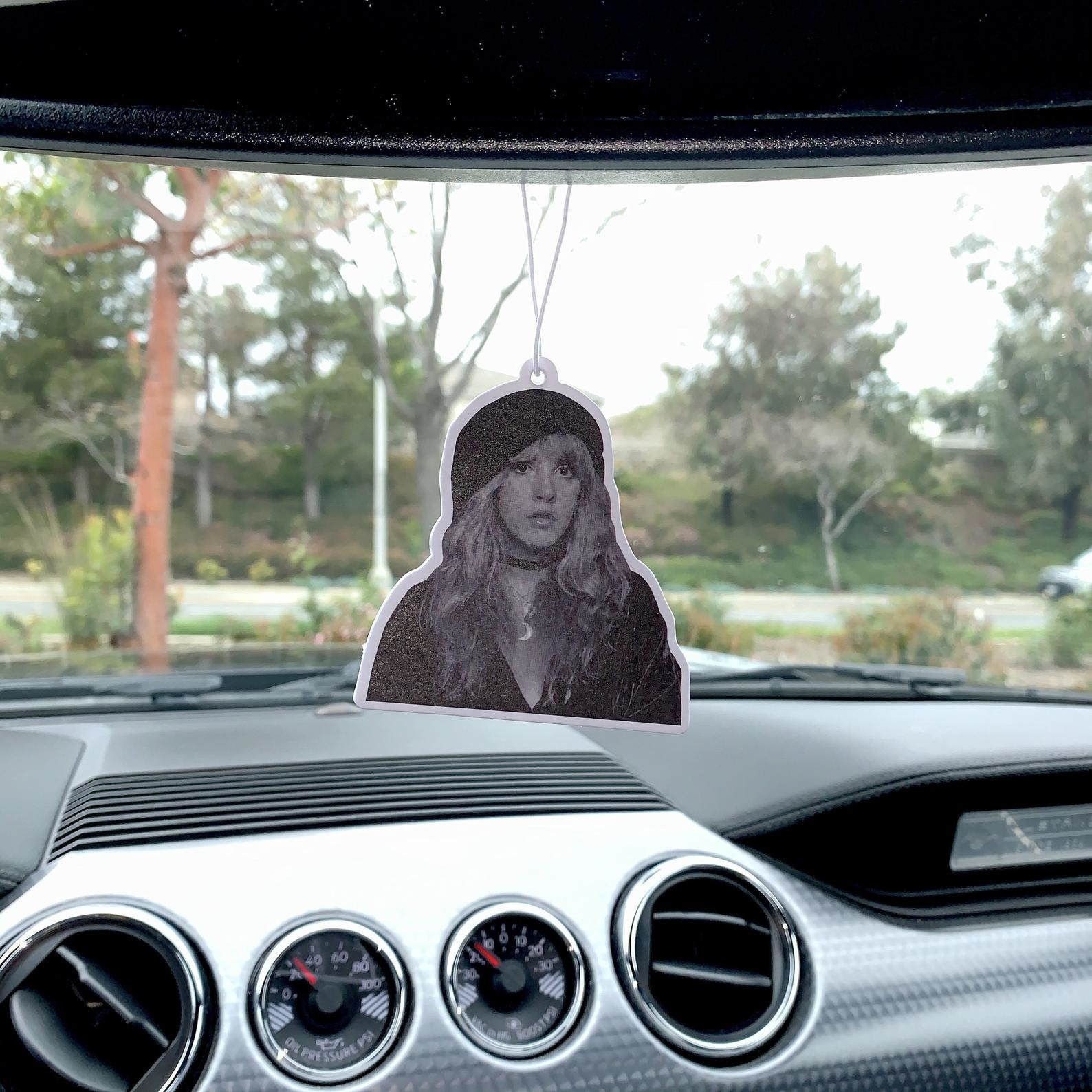 The air freshener which is a black-and-white photo of a young Stevie Nicks