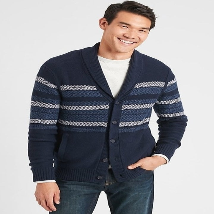 Model wearing navy and gray patterned cardigan