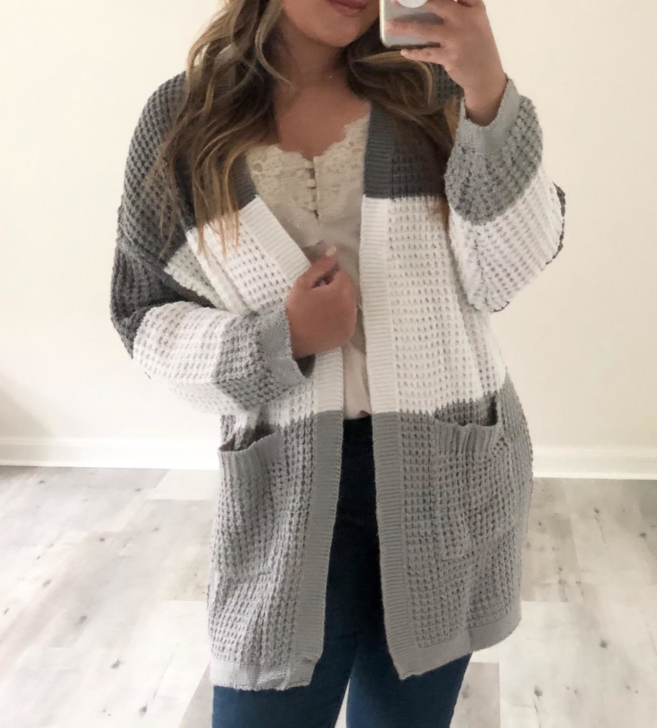 Reviewer wearing cardigan in the shade contrast-gray