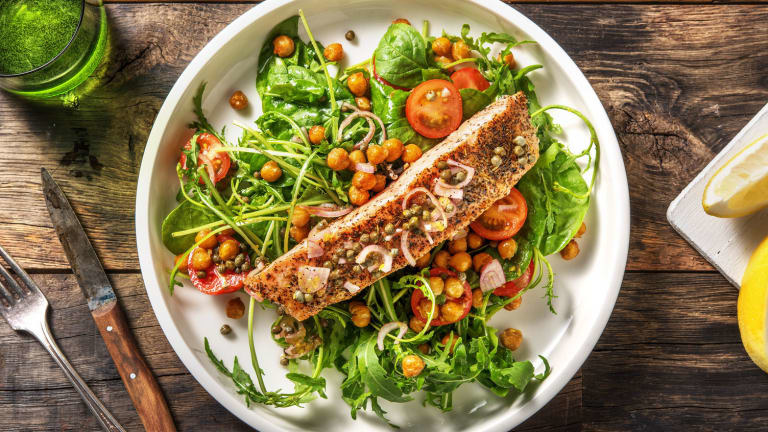 Italian spiced salmon with arugula salad, chickpeas, tomatoes, and capers