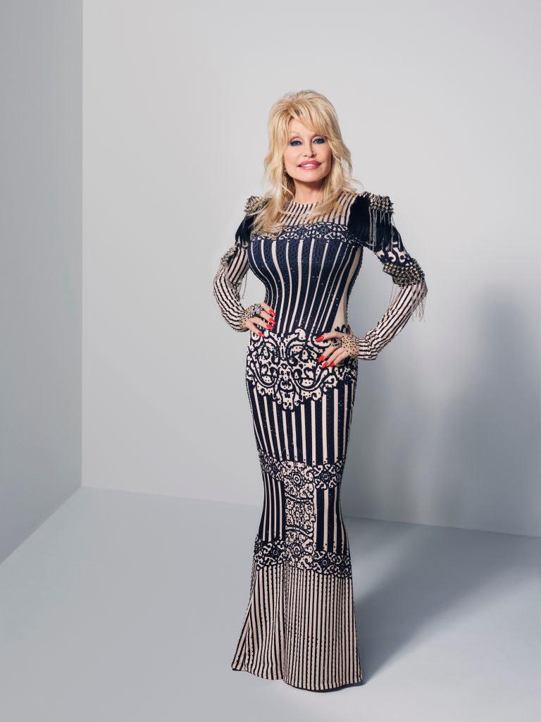 Dolly Parton wearing a dress to the cma awards
