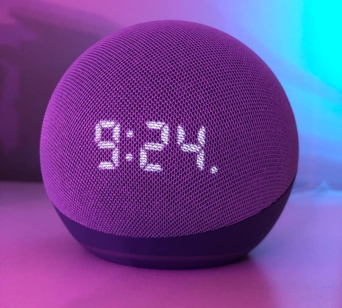 "The Echo Dot 4th Gen displaying the time ""9:24"""