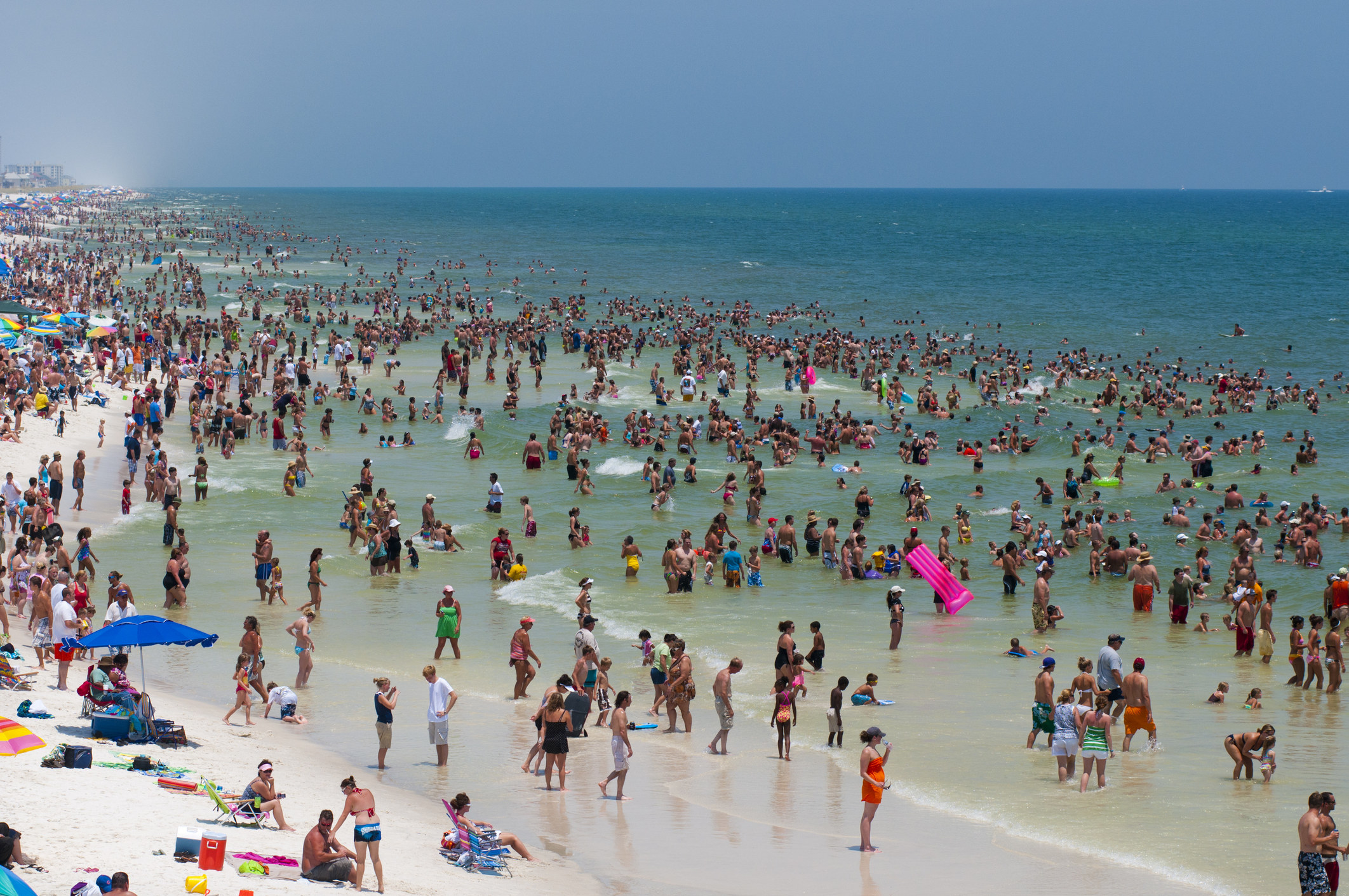 A beach in Pensacola filled with people