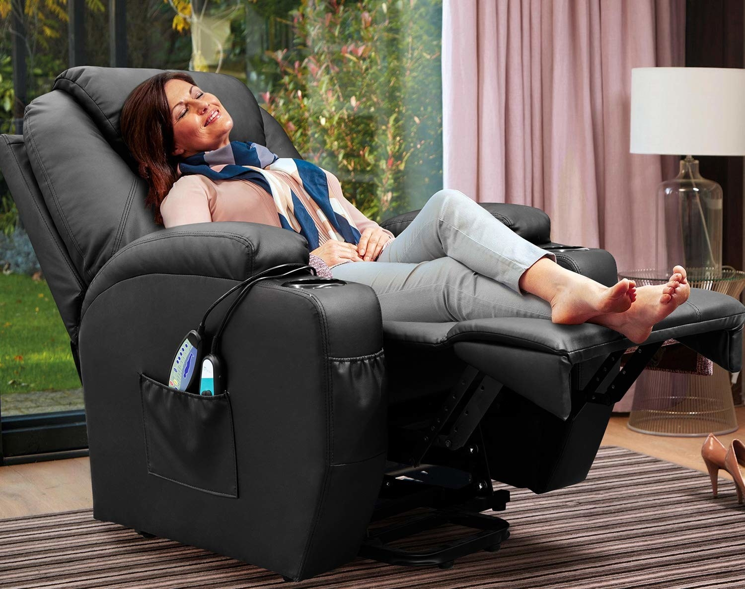 person relaxing in a recliner with their feet propped up