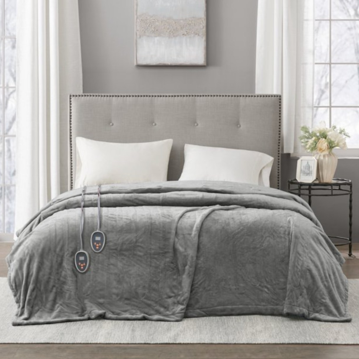 The heated plush blanket in gray