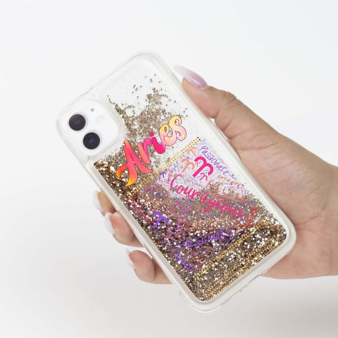 A person holding the Aries phone case