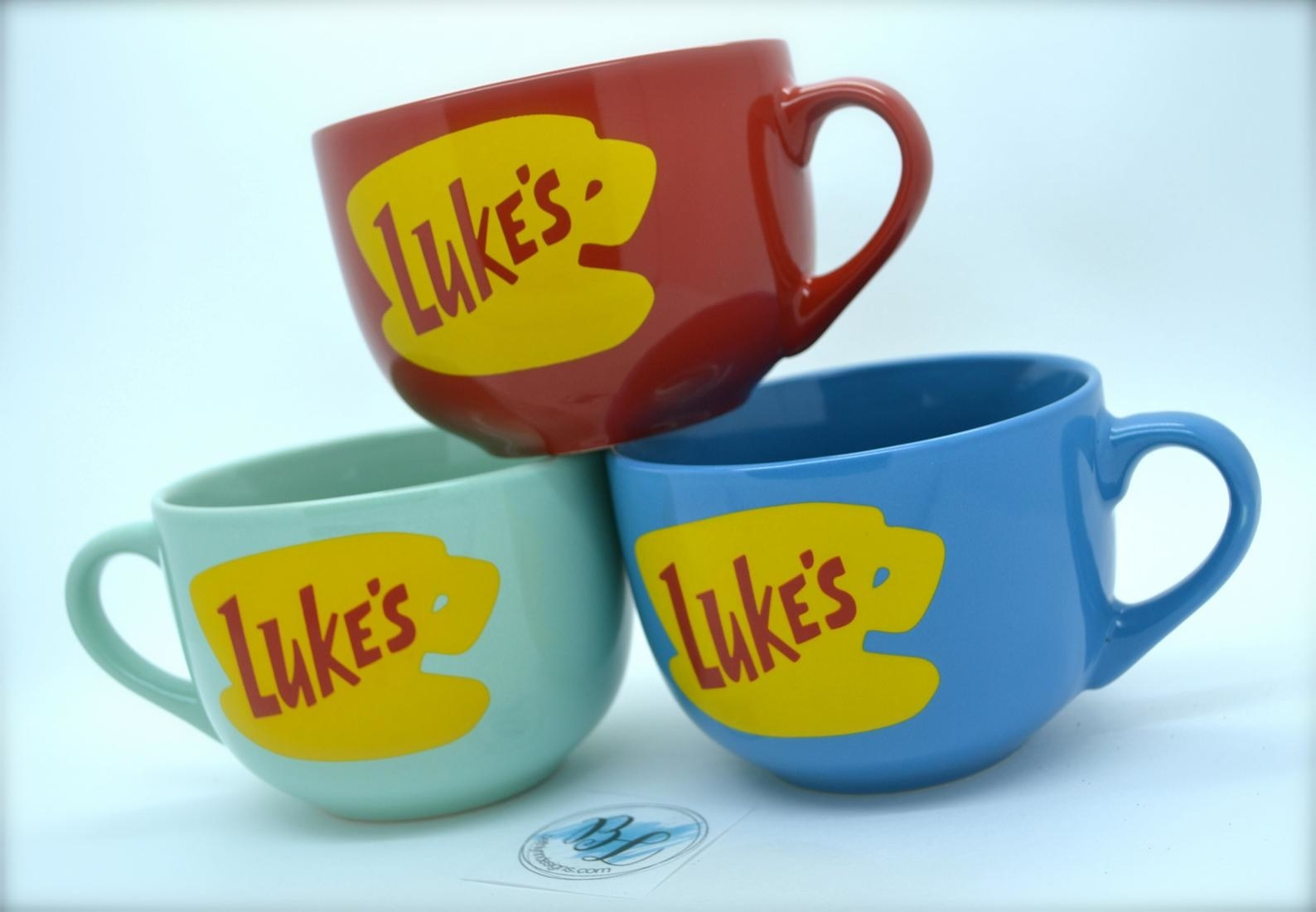 the mugs in red, mint, and blue with the Luke's logo printed on them