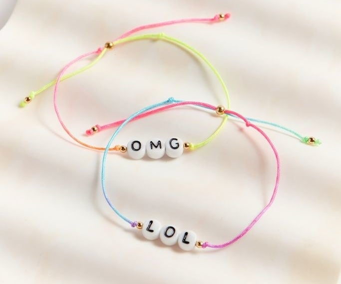 the OMG/LOL bracelets with multi-color bands and a gold clasp to seal