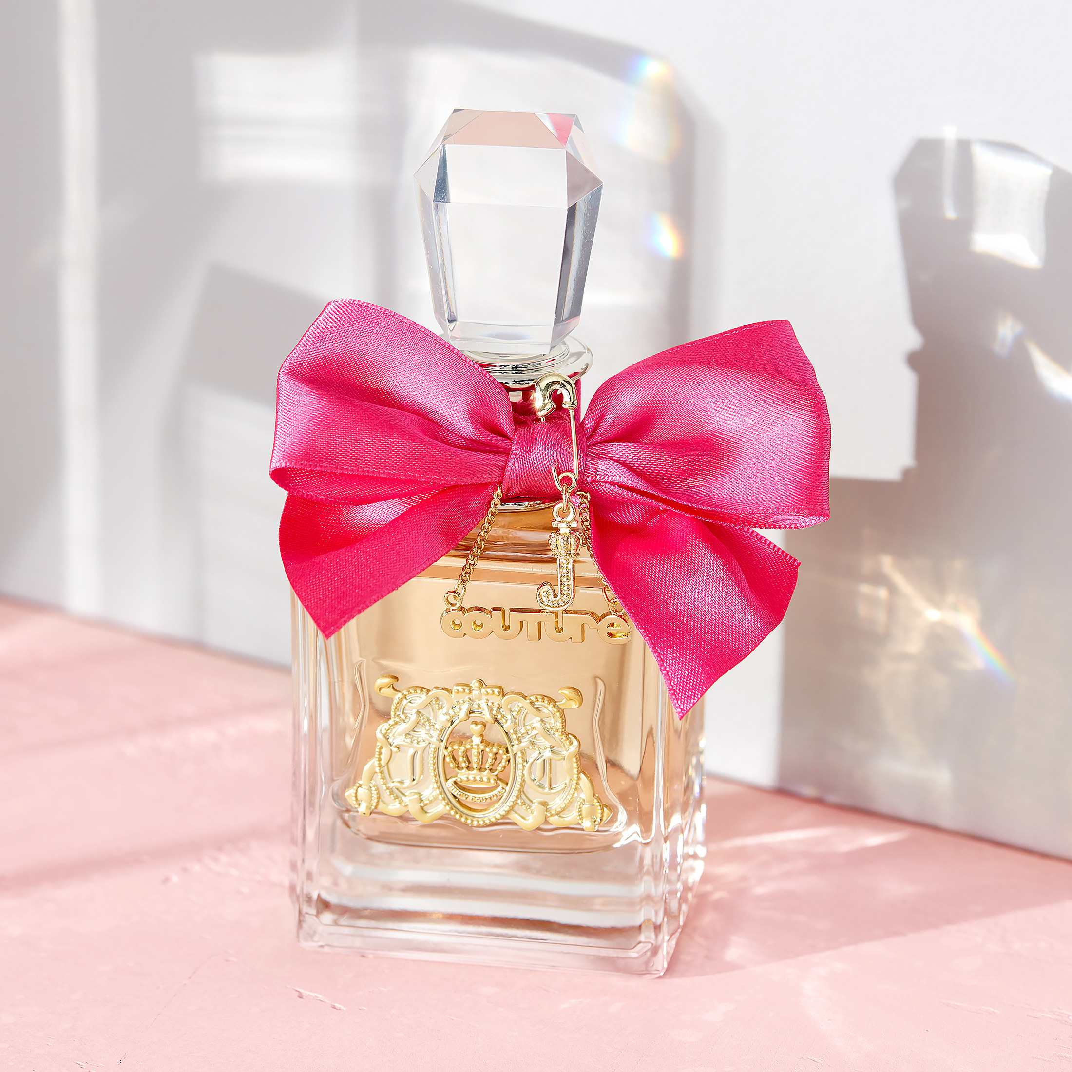 juicy couture viva la juicy perfume bottle with a pink bow on it
